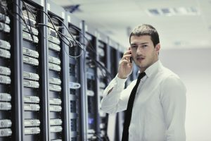 -It engeneer talking  phone at network room-Technodal